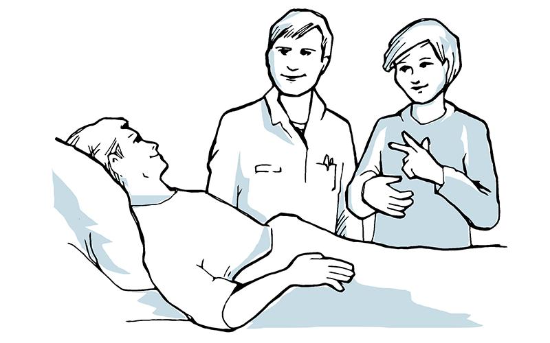 Bilde av pasient i sykesengen, med besøk av lege med tolk